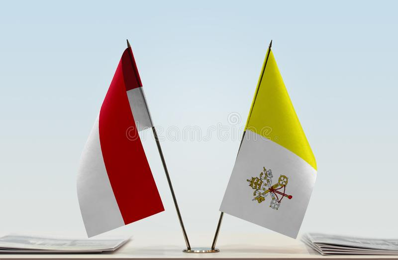Flags of Monaco and Vatican. Two table flags of Monaco and Vatican royalty free stock photography