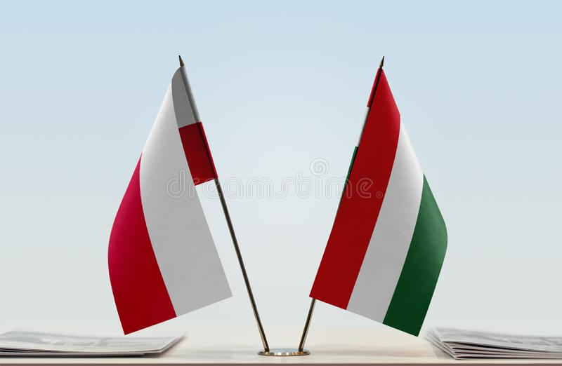 Flags of Poland and Hungary. Two table flags of Poland and Hungary royalty free stock image