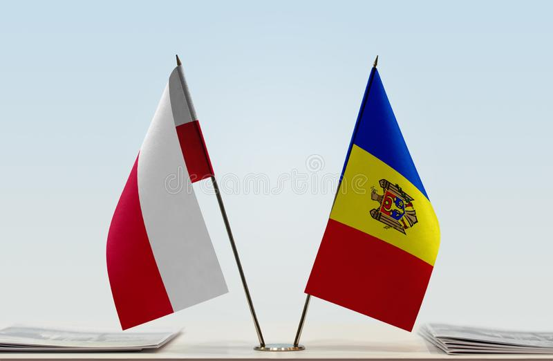 Flags of Poland and Moldova. Two table flags of Poland and Moldova royalty free stock photos