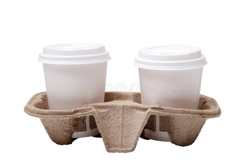 Two take-out coffee in holder. Isolated on a white. Two take out coffee cups in pressed cardboard cup holder isolated stock photo