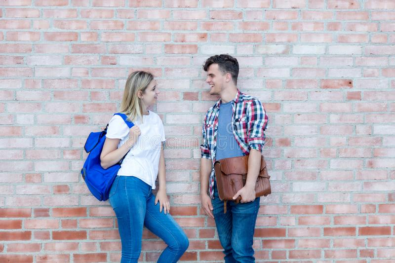 Two talking german male and female students stock photos