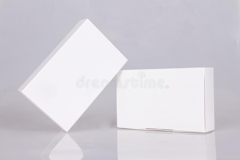 Two tall white boxes. Mockup ready for your design. Box perspective. Box template. Box empty blank. Two tall white boxes whith reflection. Mockup ready for your royalty free stock photo