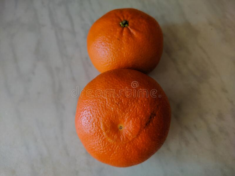 Two tangerines on the table. View from above stock image