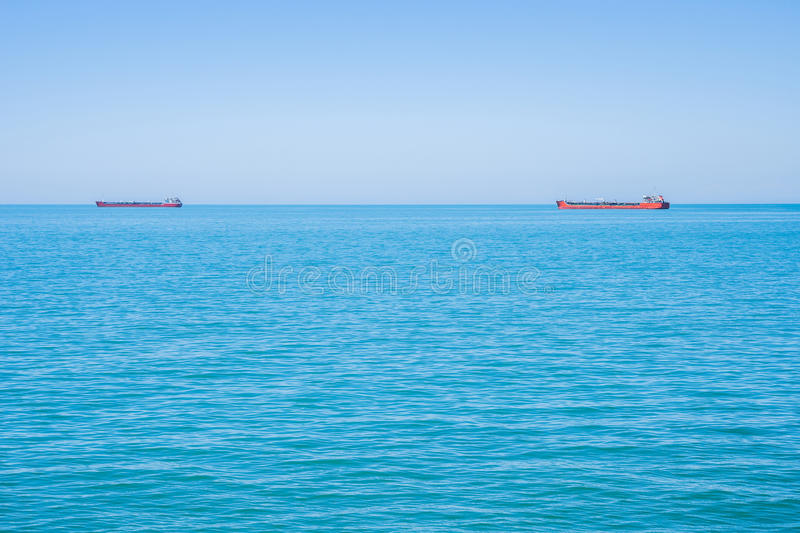 Two tankers on the horizon of the Black Sea.  stock photo