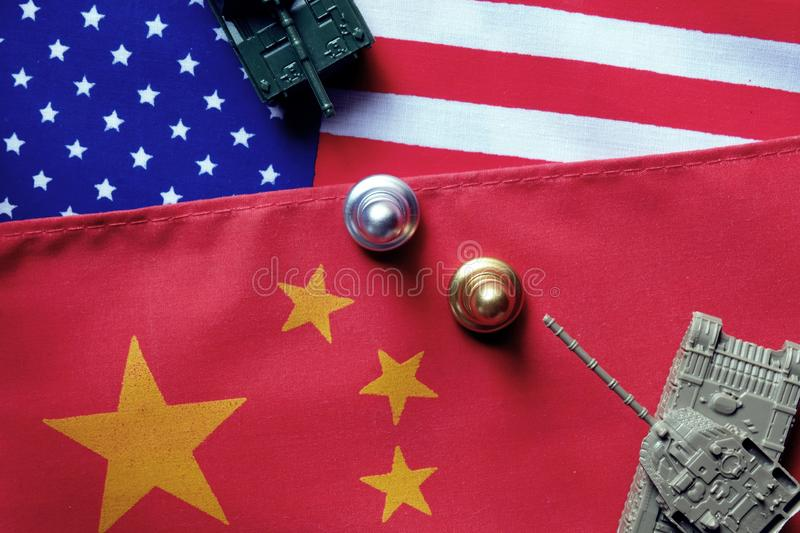 Two tanks face to face on USA and China national flag background. Refer to conflict between two countries is heating up. China and stock photo