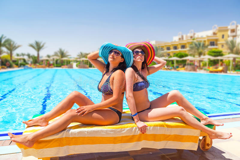 Download Two Tanned Girls At Swimming Pool Stock Photo - Image: 33761566
