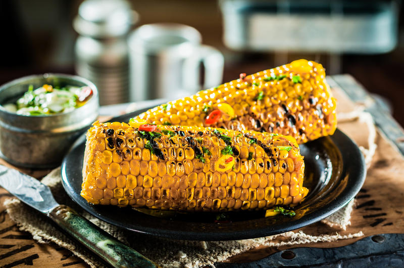 Two tasty grilled corncobs royalty free stock photo