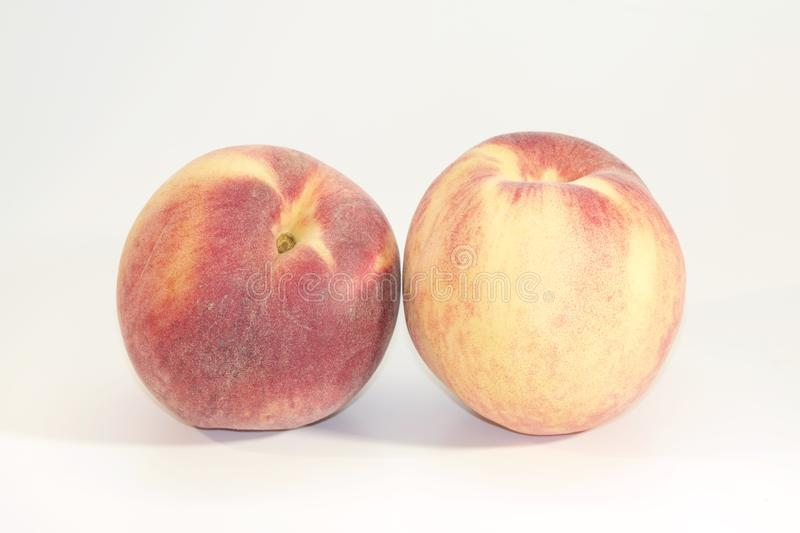 Two Tasty Peaches royalty free stock image