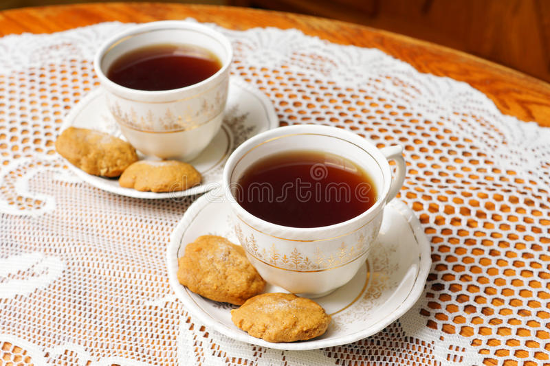 Two tea cups with gold