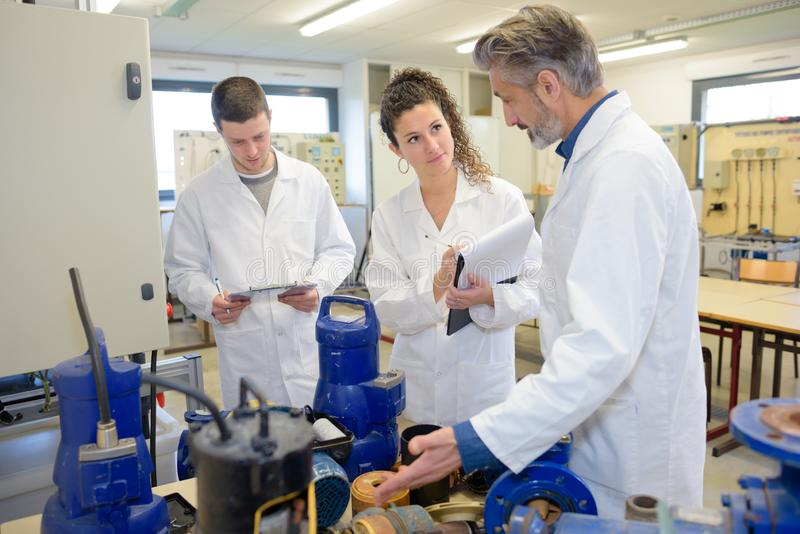 Two technical school students in class. Technical stock images