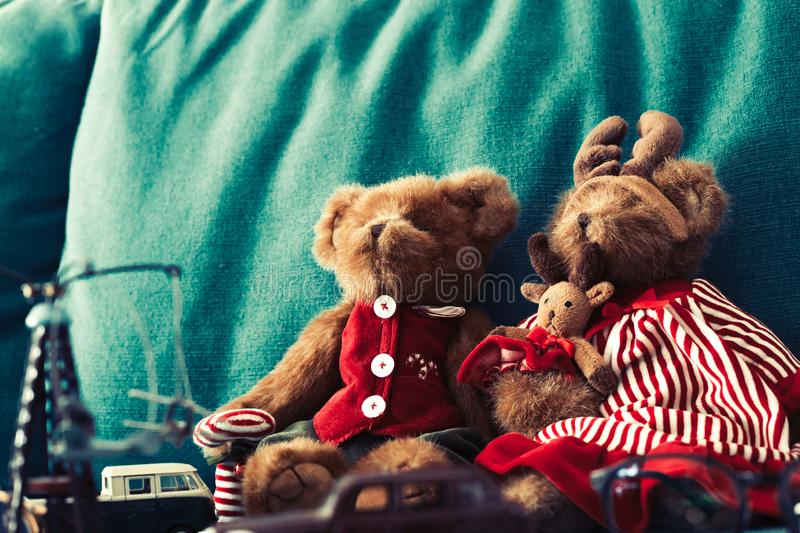 Two Teddy bear are sitting on sofa. royalty free stock photos