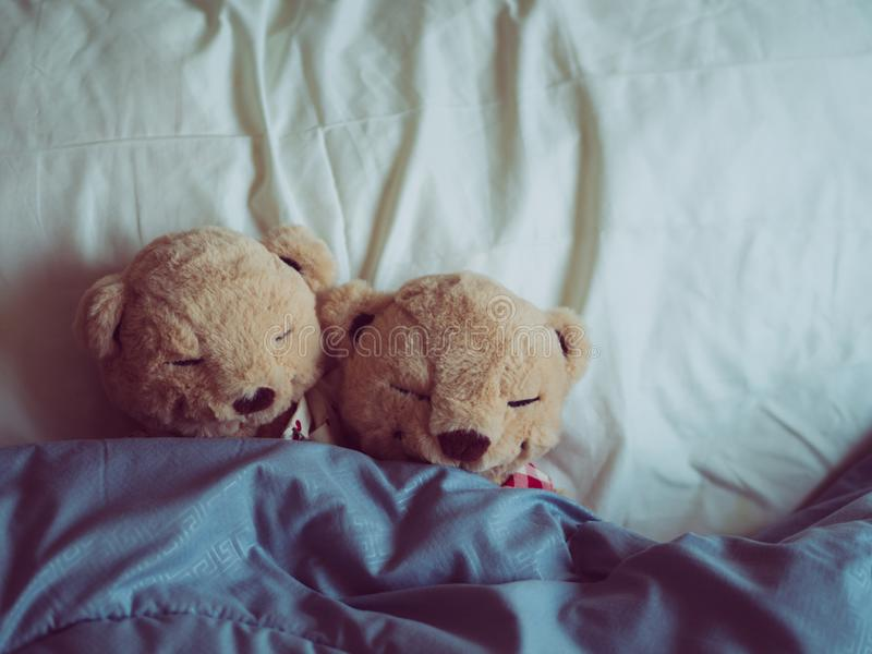 Two teddy bears in the bed, Teddy Bear Lovers. Valentine concept, Two teddy bears couple,Vintage retro romantic royalty free stock photography