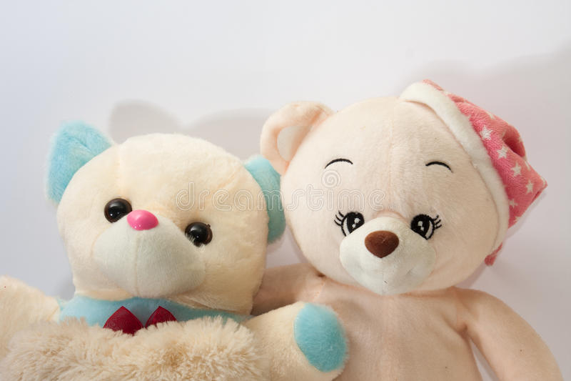 Two teddy bears hugging like friends stock images