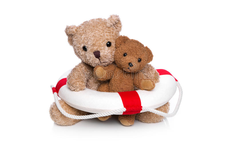 Two teddy bears with lifebelt isolated on white - concept. Mum and baby teddy bear making a swimming course stock image