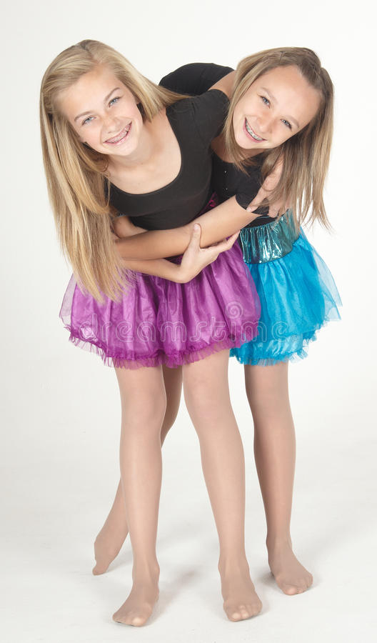 Free Two Teen Girls Modeling Fashion Clothes In Studio Stock Photo - 24423530