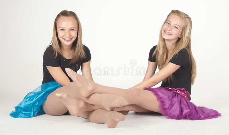 Two Teen Girls Modeling Fashion Clothes in Studio royalty free stock photos