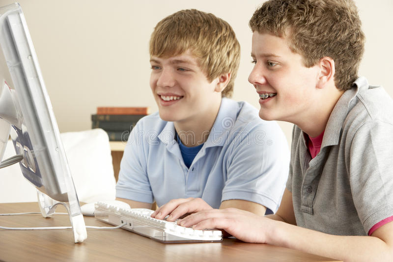 Two Teenage Boys on Computer at Home stock photography