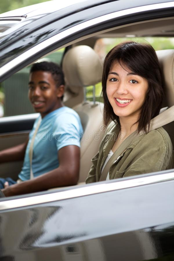 Two teenage friends driving. royalty free stock photo