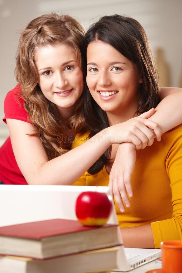 Two Teenage Friends Hugging Stock Photo