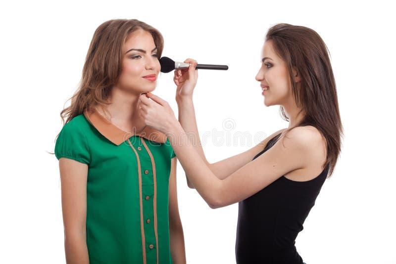 Two Teenage Girls Applying Blush Royalty Free Stock Image