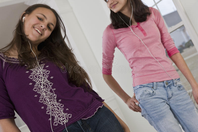 Two teenage girls dancing together at home royalty free stock images