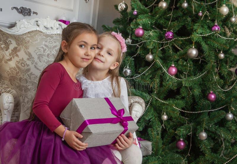 Two teenage girls with gifts at Christmas studio stock image