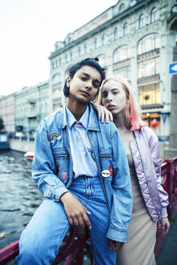 Two teenage girls infront of university building smiling, having fun, lifestyle real people concept close up royalty free stock photography