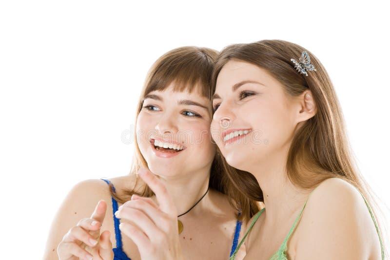 Two teenage girls looking up
