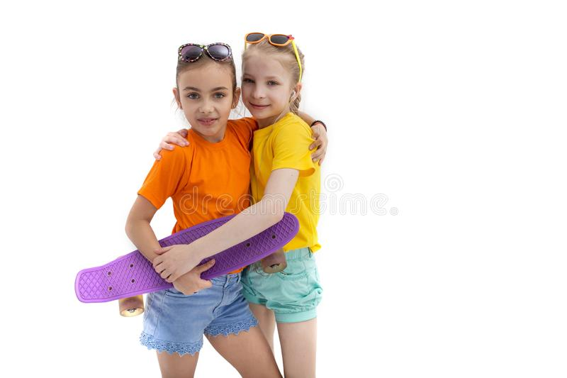 Two teenage girls with skateboard royalty free stock photography