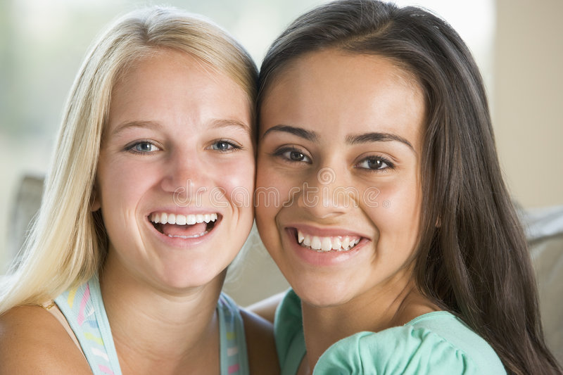 Download Two Teenage Girls Smiling stock photo. Image of teenagers - 6882904