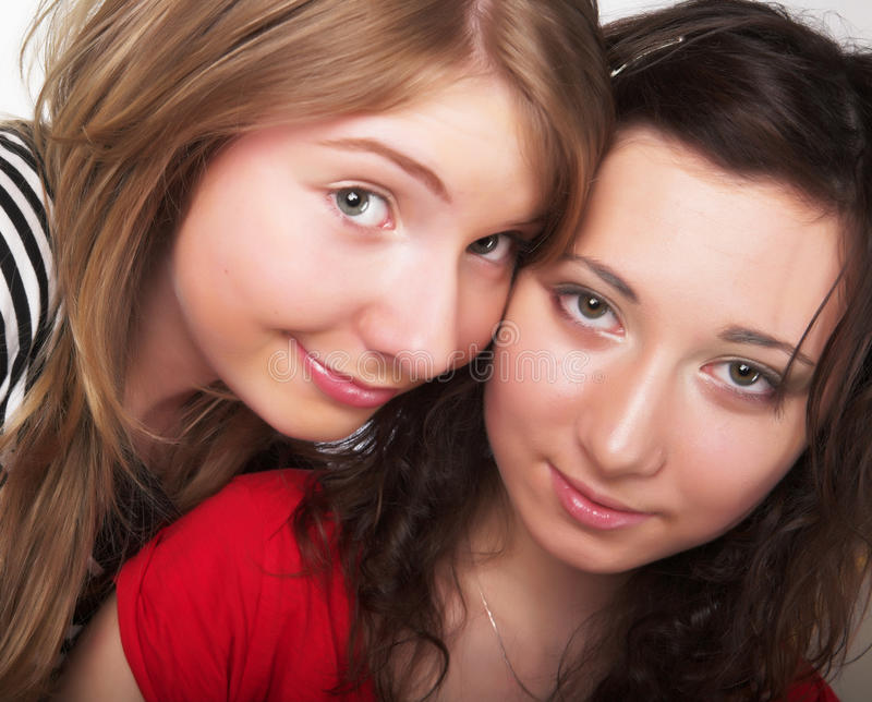 Two teenage girls together smiling royalty free stock photography