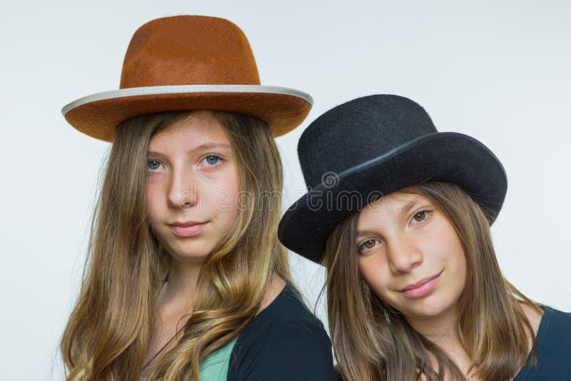 Two teenage girls wearing hats stock image