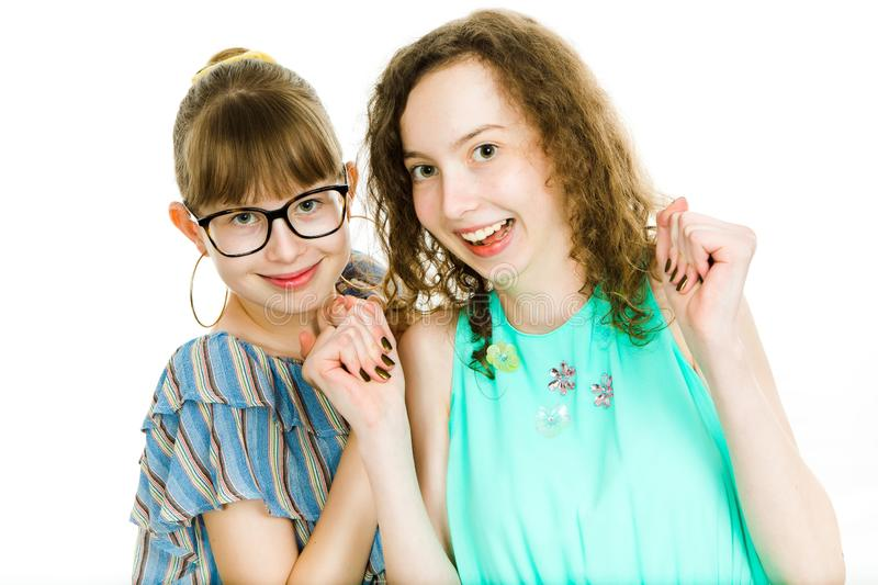 Two teenaged sisters posing together - smiling - happiness stock images
