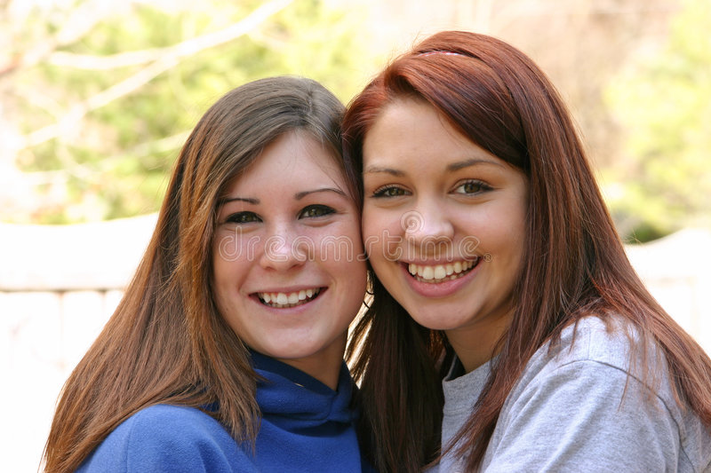 Two Teenagers. Two pretty young girls with big smilies royalty free stock image