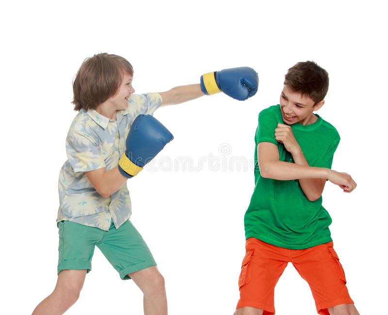 Two teenagers Boxing. Two boy have fun Boxing each other - Isolated on white background stock image