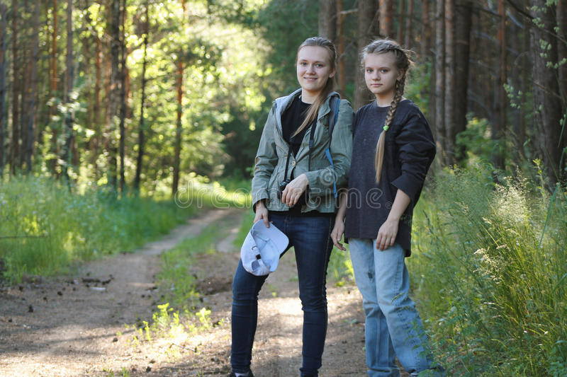 Two teenagers girls sisters friends in park - summer outdoor royalty free stock photography