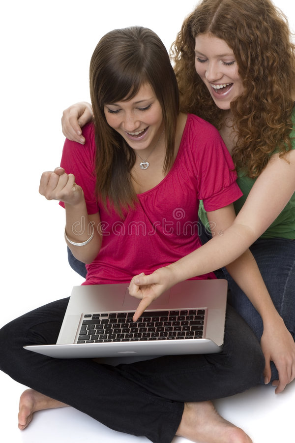 Two teenagers with laptop computer. Girls chat on the Internet stock images