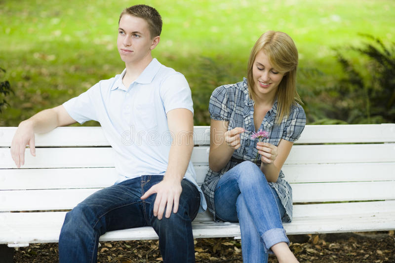 Two Teens on Bench royalty free stock photography