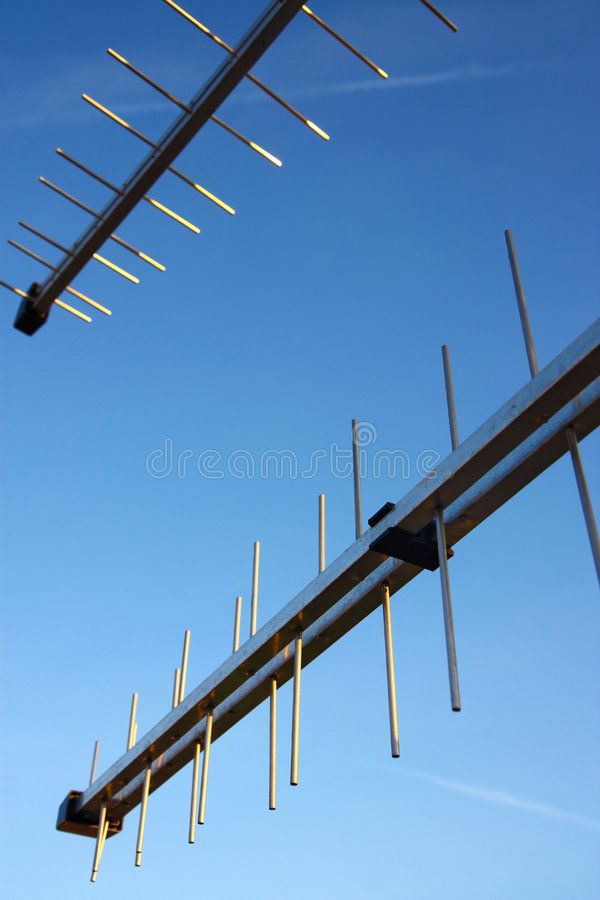 Download Two Television Antennas Under Blue Sky Stock Photos - Image: 9023983