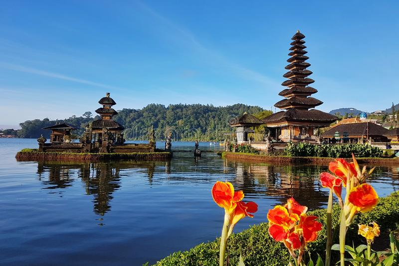 Two temples on the lake with flowers and a hill. With the best quality and resolution, can be used in your project stock photos