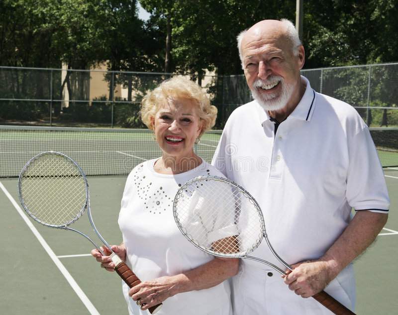Two For Tennis. An active, happy senior couple on the tennis courts