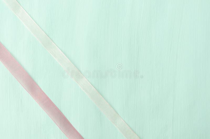 Two thin ribbons on blue-green colored surface, packaging template. Living coral-modern and trendy color of the year abstract,art,background,beautiful,beauty royalty free stock photo