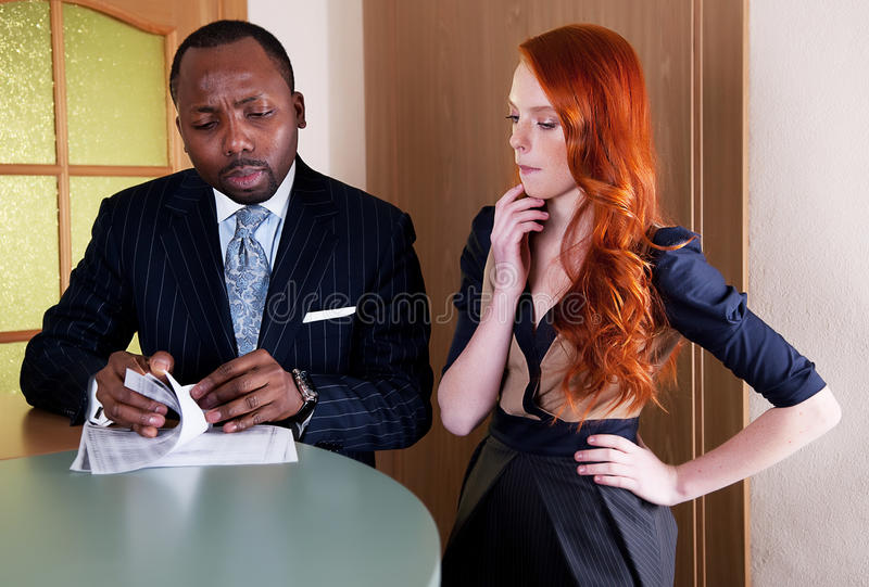 Two Thinking Coworkers At Office Counter Stock Photography