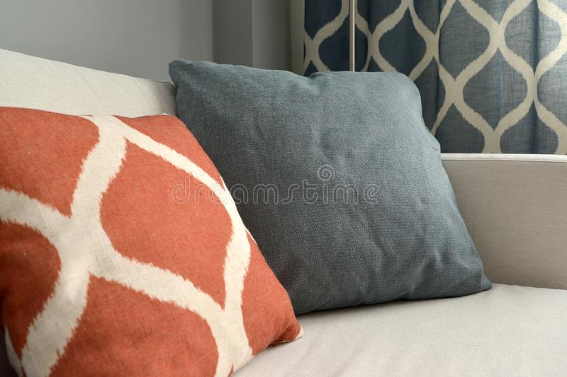 Two throw pillows lie on a sofa. Living room interior fragment royalty free stock photography