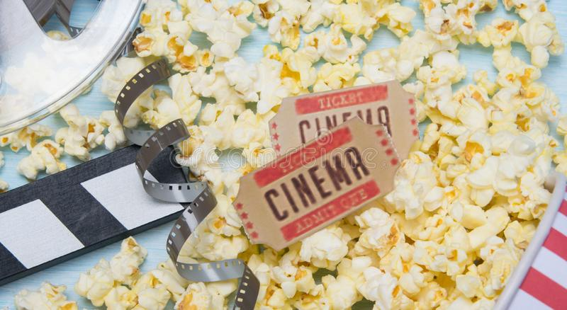 two tickets to the movies, against the background of popcorn and a film stock photos