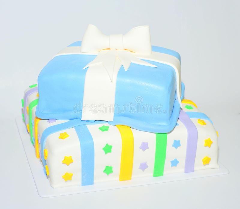 Two tier square present box cake. Two tiers square cake shaped like present boxes royalty free stock images
