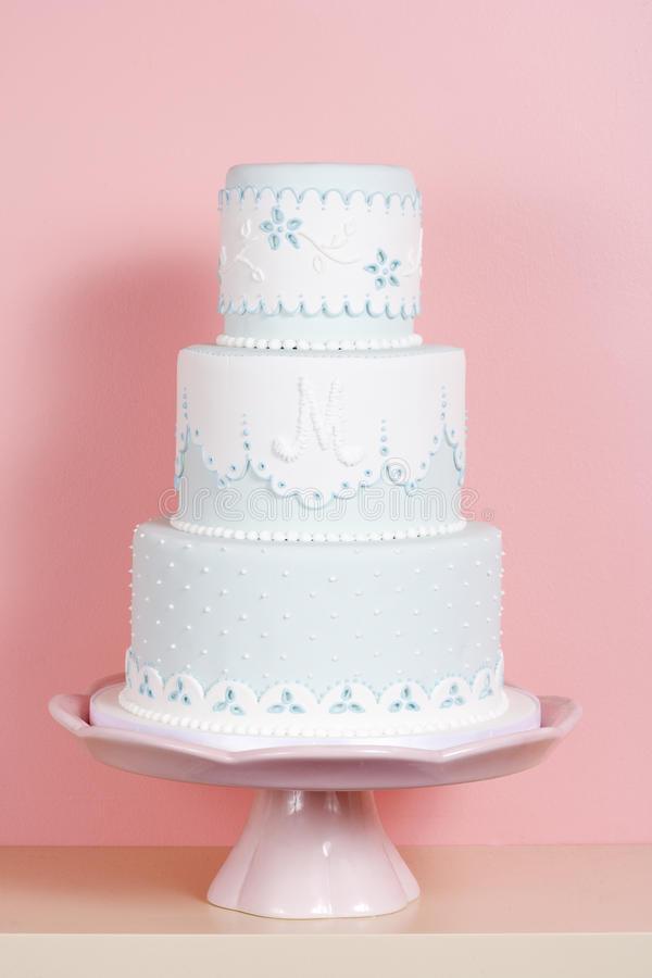 Two-tiered Cake Against Pink Background stock photos