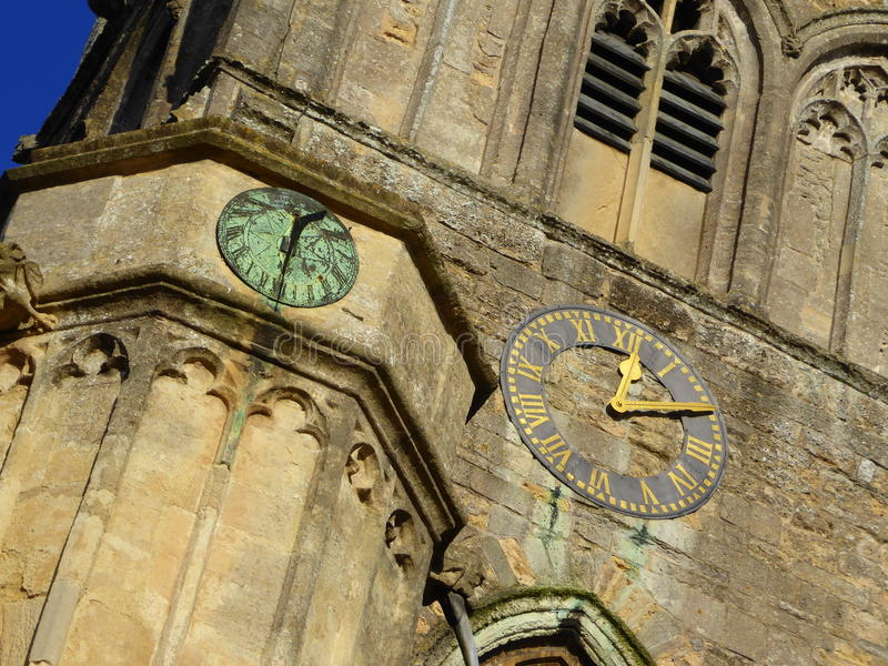 Sundial and clock on church tower. A clock and sundial on Axbridge church, Somerset, England royalty free stock photography