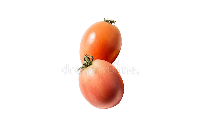 Two tomatoes isolated on white background stock photo