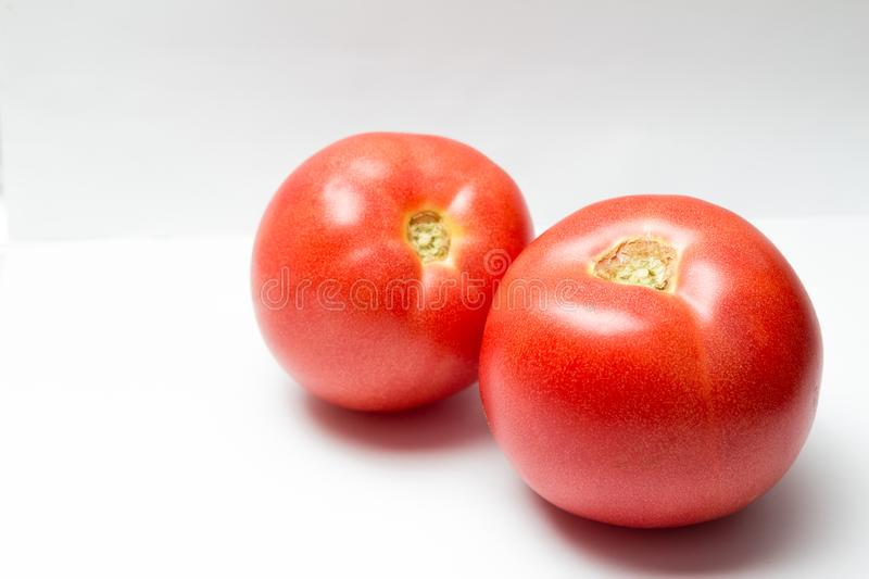 Two tomatoes isolated stock photo